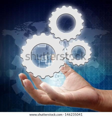 Teamwork Gear symbol on hand , Business background