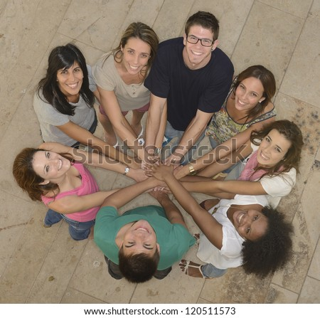 Teamwork: Group of young and diverse people joining hands
