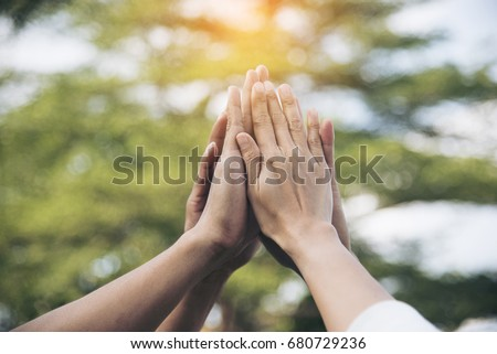 Photo of  Teamwork high five as team together hands air greeting  power tag team. Group of diversity people multiethnic  unity togetherness in Volunteer community. Collaboration Business Team success concept.