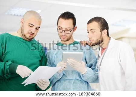 Teamwork of doctors working with tablet pc at hospital for discussion