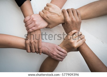Teamwork of young people United Hands together expressing positive, tag team, team, friendship, spirit, one heart,  mission, connection, partnership, deal, volunteer and diversity concepts.  #577909396
