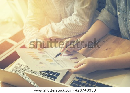 Teamwork process.Business people discussing the charts and graphs showing the results of their successful cooperation, Analyze financial report for business plan,selective focus,vintage color filter