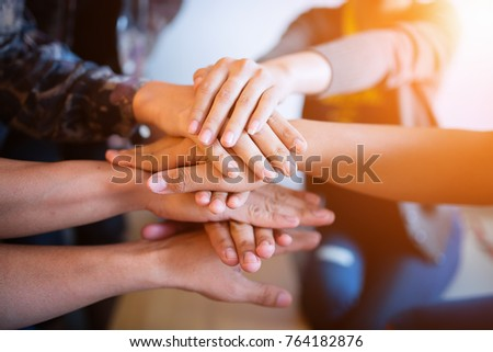Teamwork putting their hands together,join hands partnership and teamwork concept. #764182876