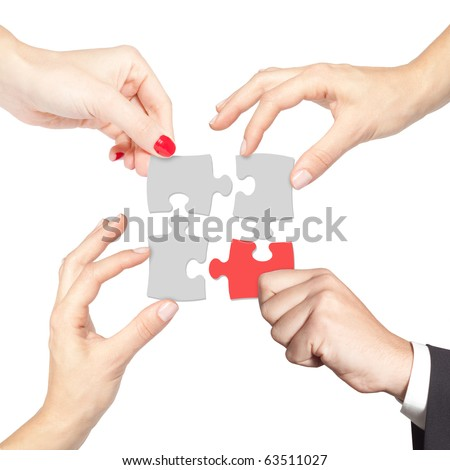 Teamwork solving a puzzle isolated on white