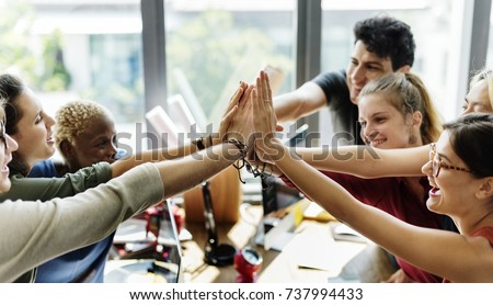 Teamwork successful high five together