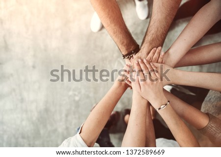 Teamwork, unity concept, group of friends put their hands together with copy space #1372589669
