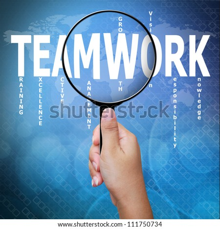 Teamwork, word in Magnifying glass ,Business concept