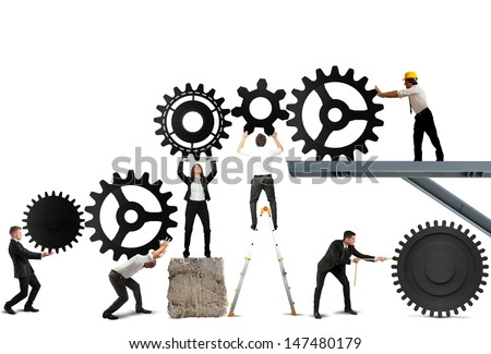 Teamwork works together to build a gear system