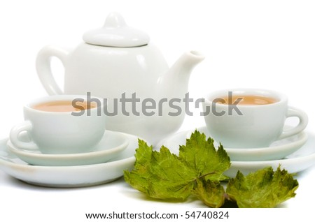 teapot and white teacup on white background