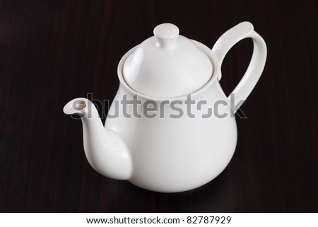 teapot on table.