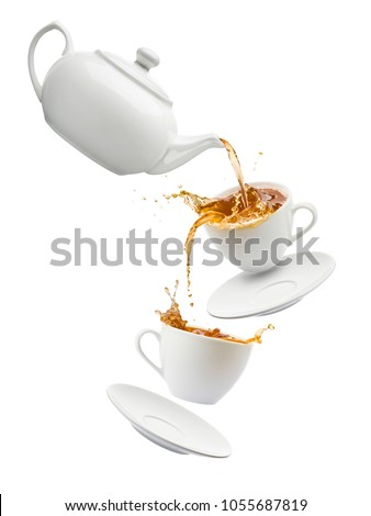 teapot pouring tea into flying cups, on white background
