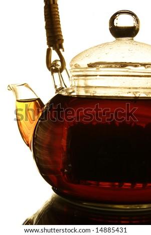 Teapot with fresh tea on white background