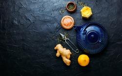 Teapot with ginger tea and honey.Vitamin,healing tea.Healthy ginger tea with lemon.Alternative medicine
