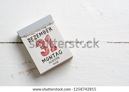 tear-off calendar with 31st of december 2018, silvester (in German) on top #1258742815