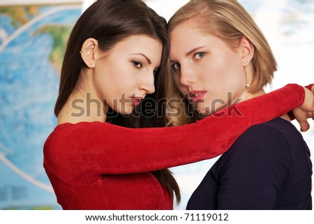 Tearful goodbye by two women at airport