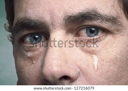 Tears in eyes of crying adult man Foto stock ©