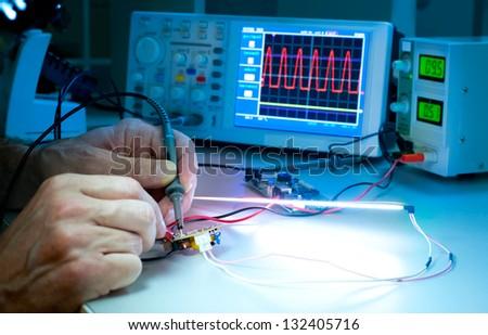 tech tests electronic equipment ...