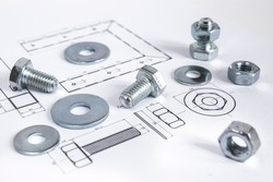 Technical drawing with bolts and nuts. Close-up picture taken in studio with soft-box.