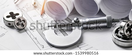 Technical drawings with measure tools. Pencil, measurement. Papers with technical drawings and diagrams on the table. #1539980516