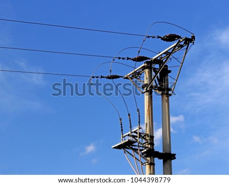 Technical picture of a three-cable medium voltage line. Tutorial. School material. Object on the background of a blue sky with clouds. Electrification of the city and country. Accomplishment of life