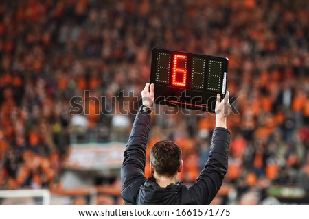 Technical referee shows 6 minutes added time during the football match.