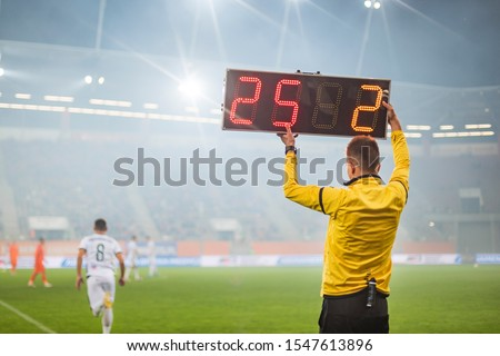 Technical referee shows players substitution during soccer match. ストックフォト ©