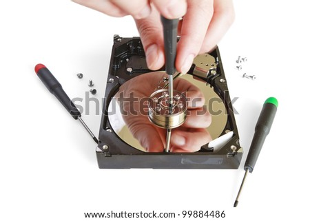 Technical surgeon working on hard drive - data recovery concept