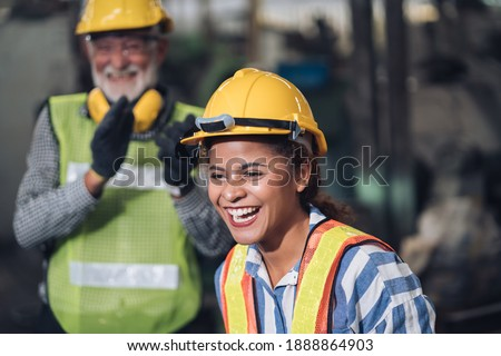 Technical team machine security system learning. Industry worker man standing in factory .Employee warehouse factory operators. women black worker happiness in factory and engineering team.