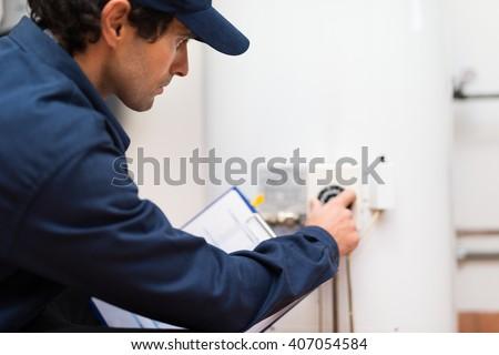 Technician adjusting a regulator
