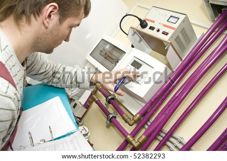 Technician at work. Servicing water & heating systems