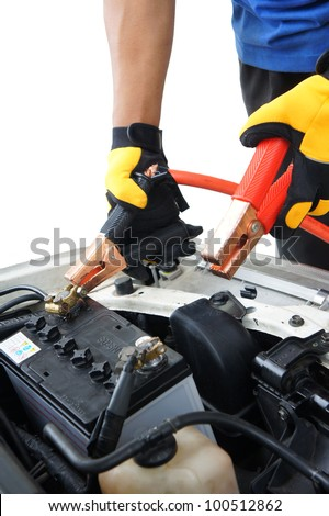 technician charge vehicle battery with isolated white background