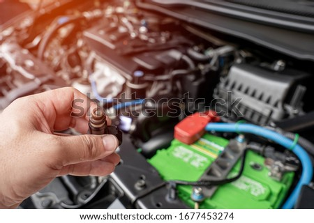 Technician check hole on old the gasoline injector part in engine room check dust and test pressure in process maintenance concept