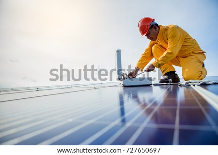 technician checks the maintenance of the solar panels. #727650697