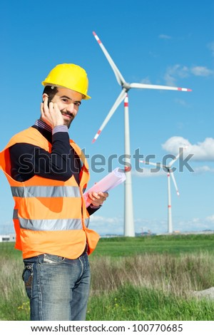 Technician Engineer in Wind Turbine Power Generator Station talk at phone, Italy