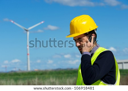Technician Engineer in Wind Turbine Power Generator talk at phone Station, Italy