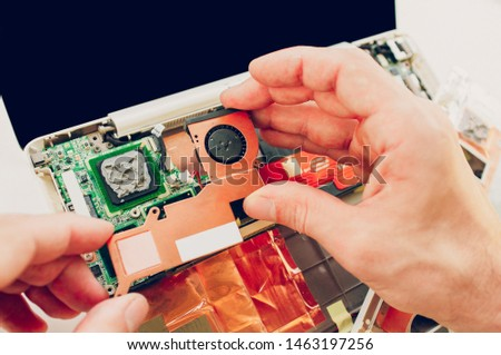 Technician expertise. Closeup of disassembled laptop components. Replacement of broken parts. #1463197256