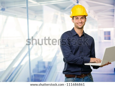 Technician Holding Laptop, Indoor