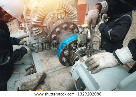 Technician inspector alignment pump  and electric motor, Repairing work in factory concept