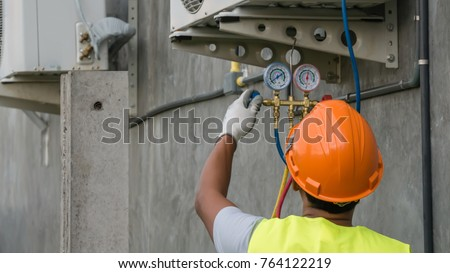 technician is checking outdoor...