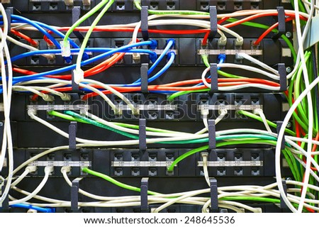 Technician is cutting wires using pliers of server in data center