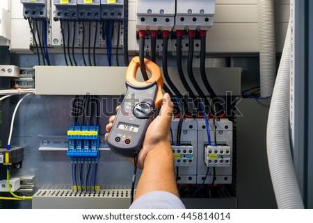 technician is measuring voltage ...