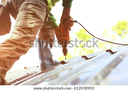 Technician is Work Roof Repair  - Shutterstock ID 612038903