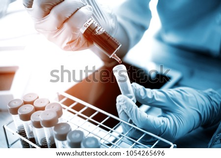 technician of health with test tubes in the clinical lab for analytical , Medical, pharmaceutical and scientific research and development concept. #1054265696