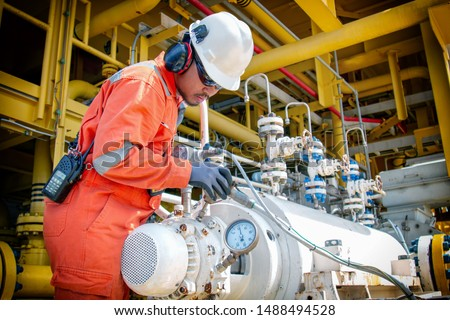 Technician,offshore worker during work in oil and gas rig platform