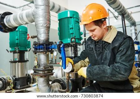 technician plumber of heating system in boiler room