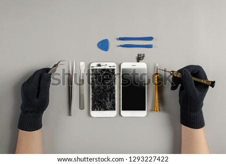 Technician prepairing to repair and replace new screen broken and cracked screen smartphone prepairing on desk