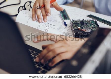 Technician-programmer repairs computer parts