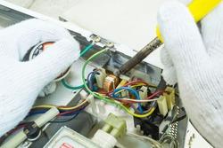 Technician repair microwave oven mainboard, Repairing microwave oven mainboard, Home appliances repair service.