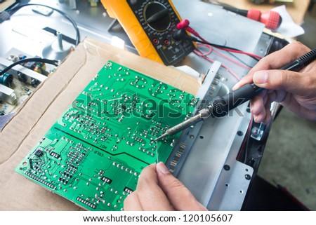 Technician repairing  a television.