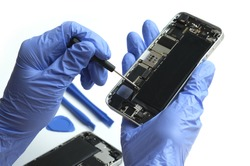 Technician repairing the Cell phone parts and tools for recovery repair phone smartphone and upgrade mobile technology,the concept of computer hardware inside.
